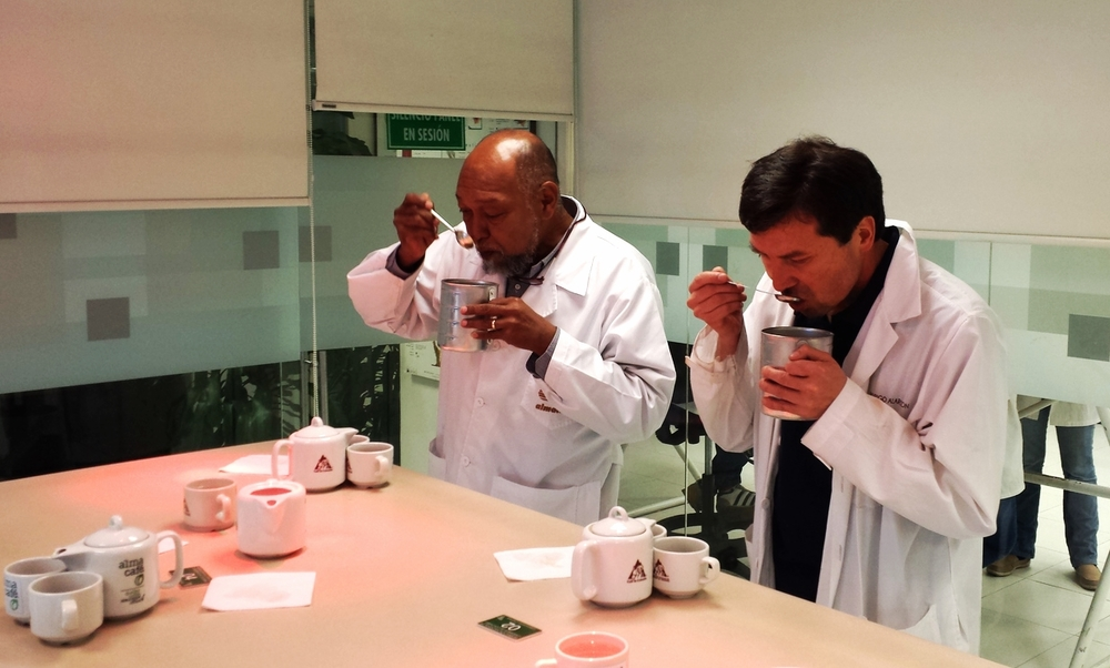 Edgar (left) cupping coffee in Bogota‏