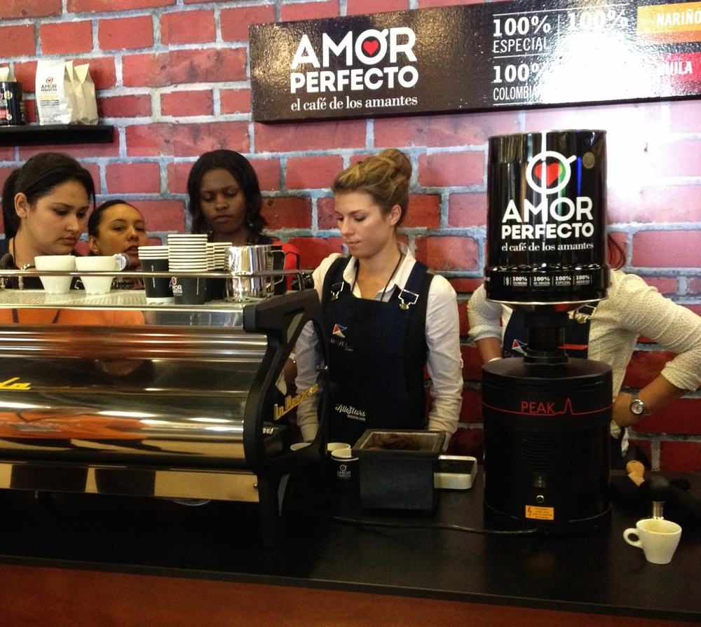 Baristas training at Amor Perfecto's stand for the Barista Female All Stars event