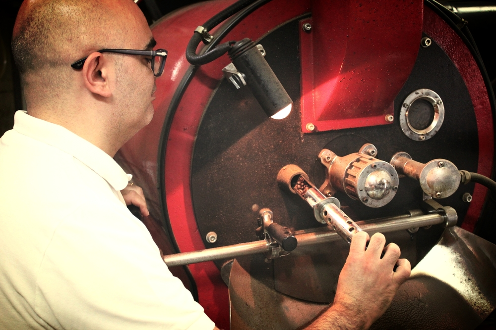 Pietro Maione checking the roasting process