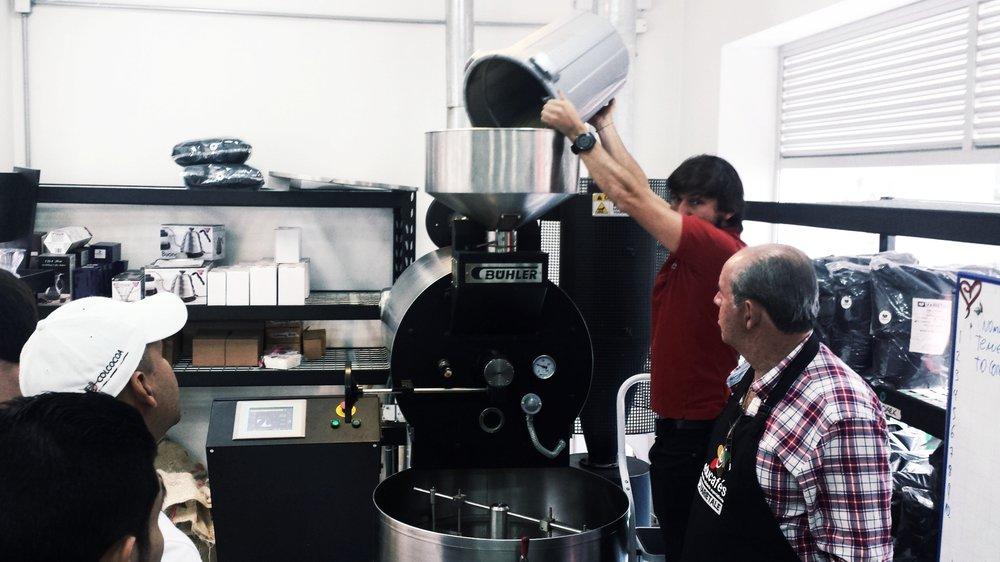 Varietale owner Abel Calderón loads beans into a Buhler Roastmaster