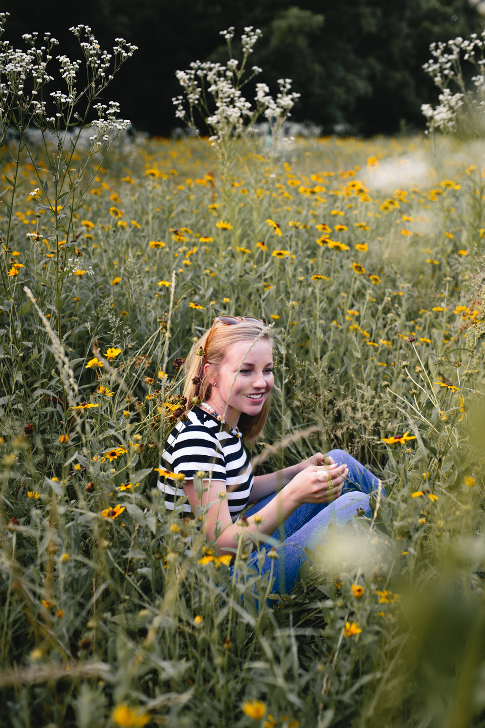 Portrait of woman in a field of flowers