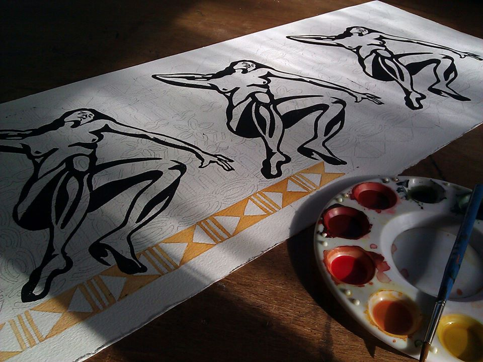 I print the lino block onto watercolor paper and after the ink has dried I sketch in pencil the tapa design. Then I begin water-coloring the background.
