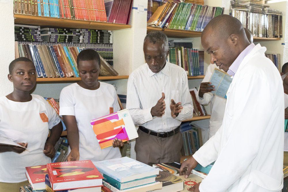 The school dean, teachers and students appreciating the textbooks