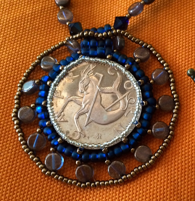 Vintage Capricorn Coin - Beaded Embroidery by Suzanne O'Clair. Contact her if you want to reserve your vintage coin for a customized necklace.