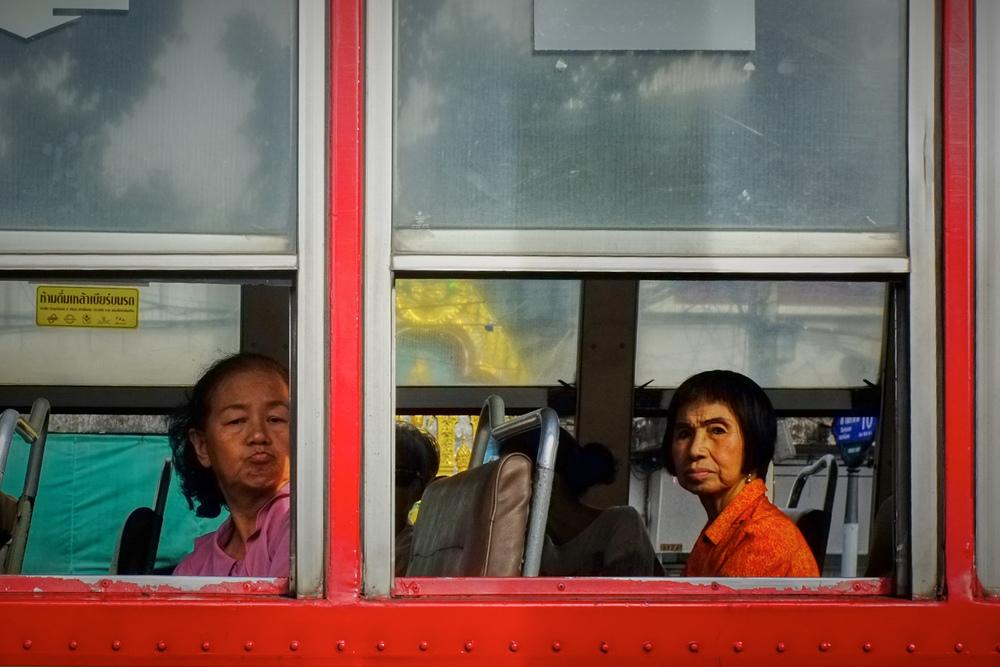 Women on a bus in Bangkok Thailand