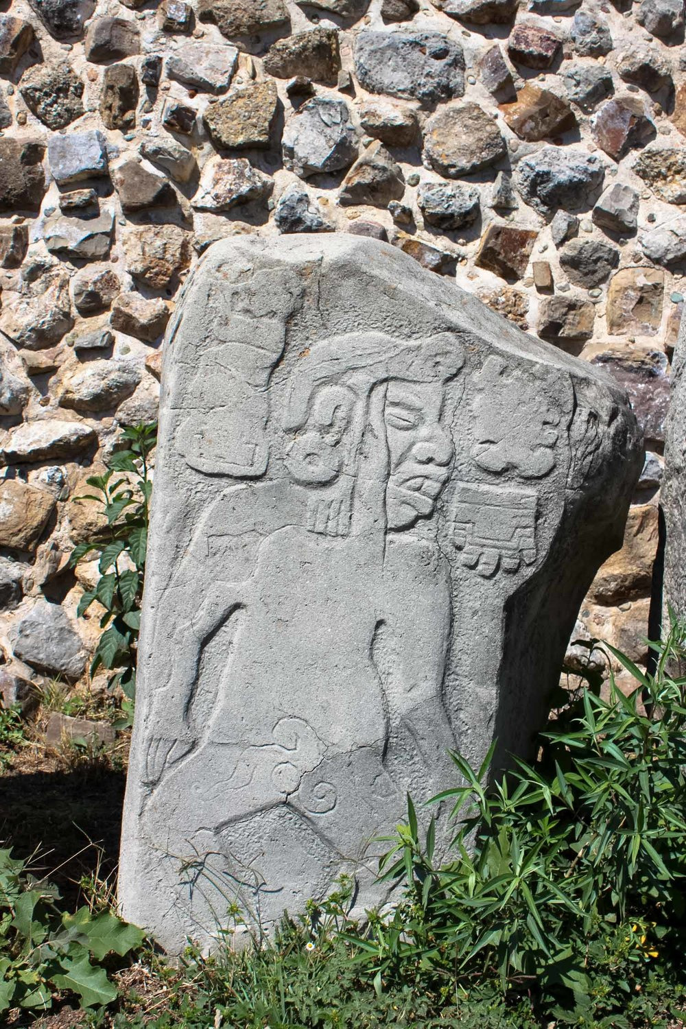 stone carving of los danzantes in monte alban oaxaca