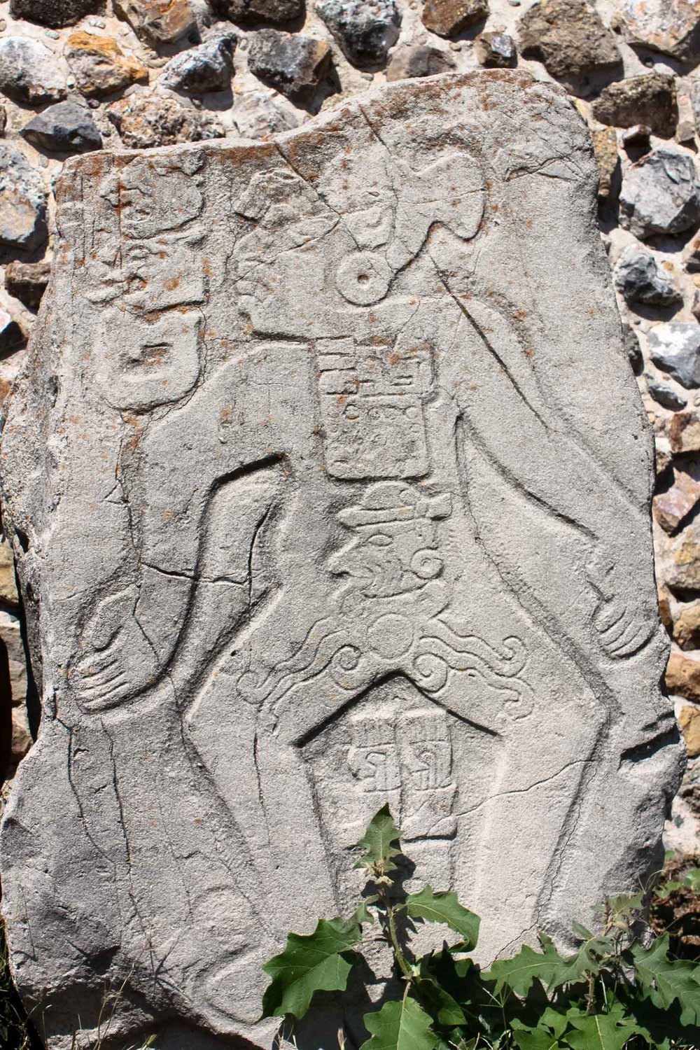stone carving of los dazantes in monte alban oaxaca