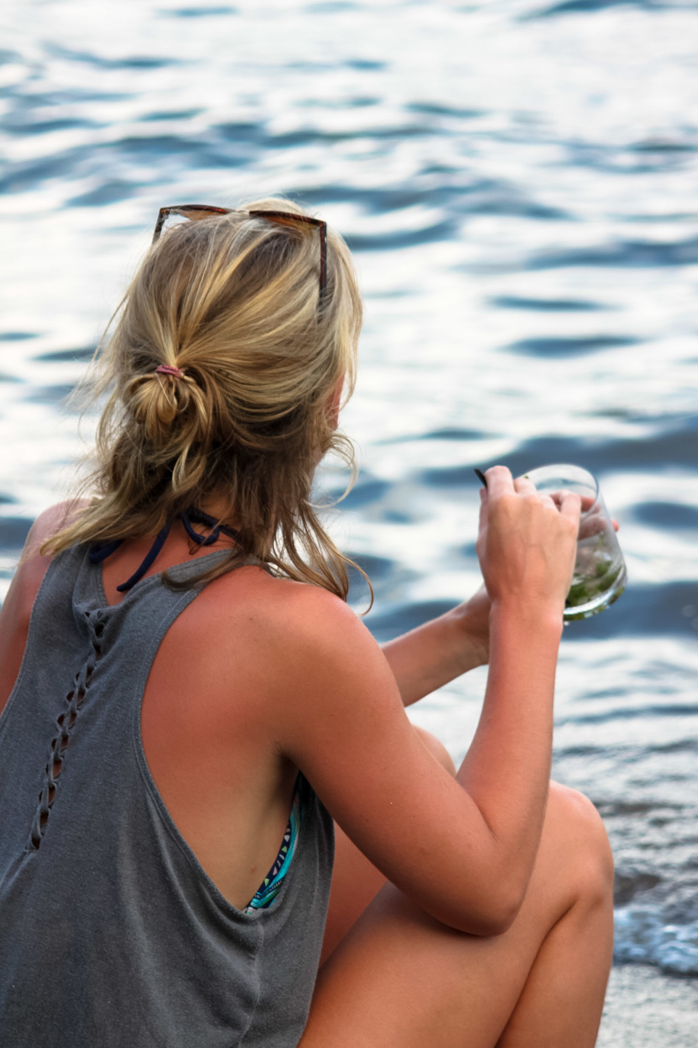 girl drinking cocktail at laguna de apoyo