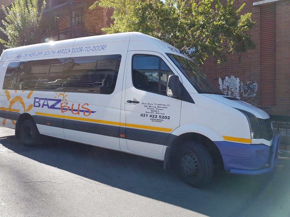 Baz Bus in front of Curiocity Hostel