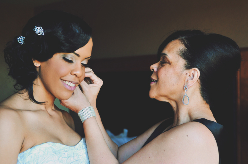 My mom helping me get ready for my wedding day in 2012.