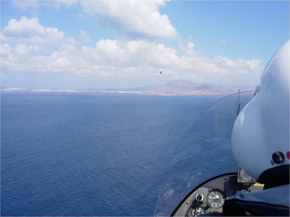 gyrocopter giro dynamics flying over the sea