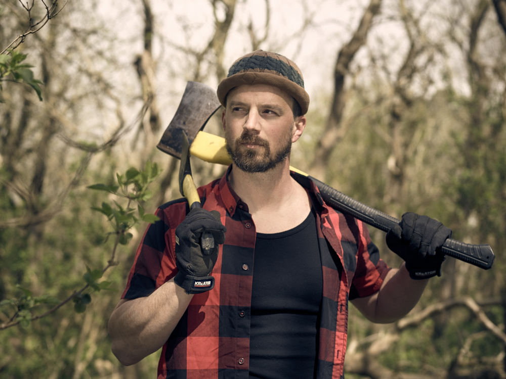 Lifestyle shhot of a business man, jogging, with family and a lumberjack look