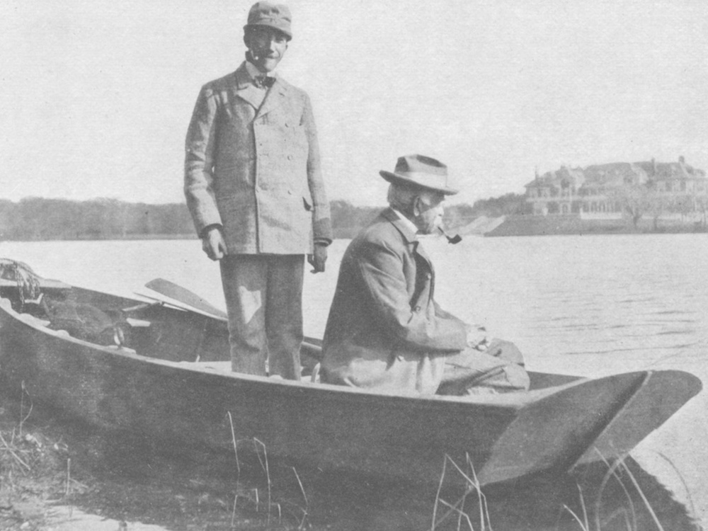 South Side Club members Frederick W. Rhinelander and A. Pennington Whitehead fishing in front of Idlehour, 1903