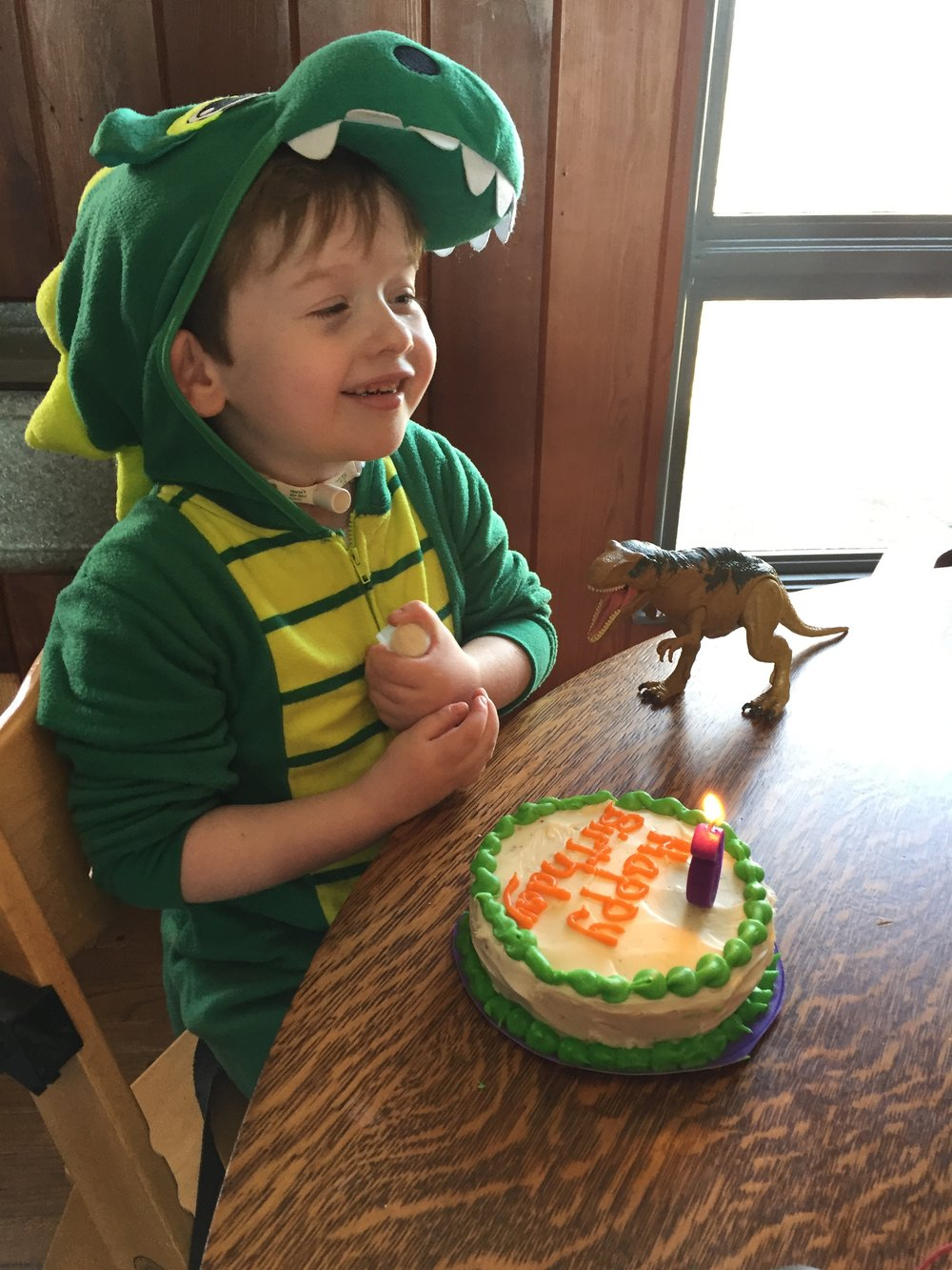 Getting ready to blow out the candle from his trach!