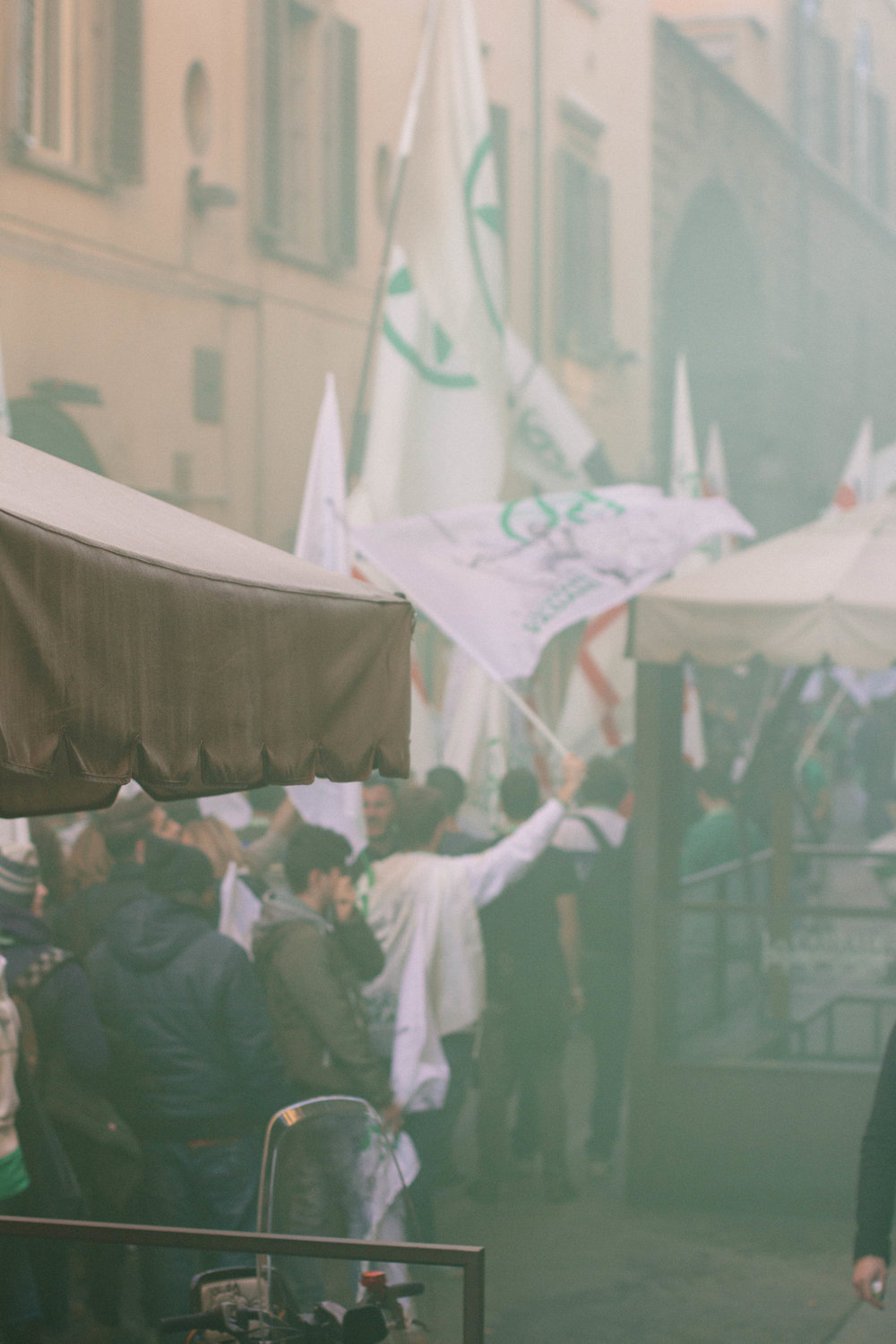 The group also brought a giant green smoke bomb that filled the street with green smoke.