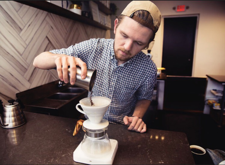 Barista Cameron McCarty (Photo courtesy of Coma Coffee)