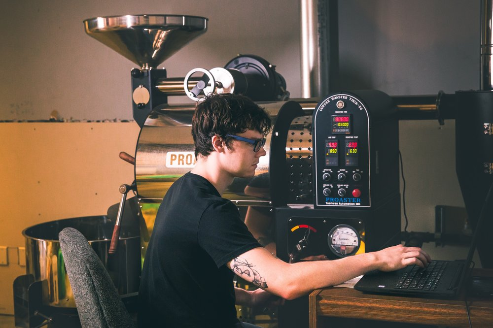 Connor James roasting something tasty (Photo courtesy of Coma Coffee)