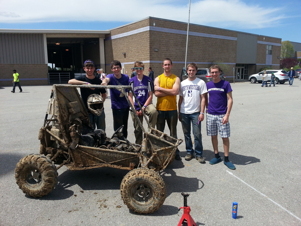 From left to right: Mikey ('16), Jared ('17), Jane ('14), Will ('14), John ('15), and Ben ('17), pictured with a muddy Spot.