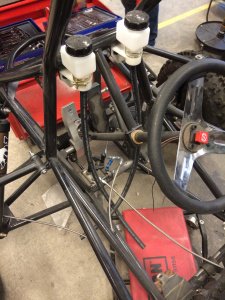 Front pedal and reservoir assembly