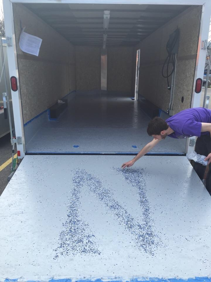 Mikey putting the finishing touches on the trailer flooring