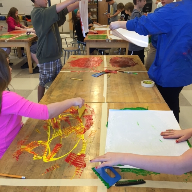 Fourth/Fifth Grade Printmaking on the table with tempera paint and mark making tools.