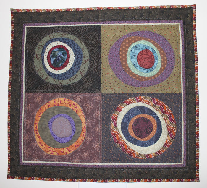 Circle of Friends  was hand appliqued, machine pieced and machine quilted. I love the effect of the wavy fabric on the lower right and border. I must look and see if I have any more of that!.