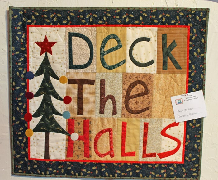 """""""Deck the Halls' is machine pieced, machine appliqued and hand quilted. Lots of exciting things happening here and out west. Our granddaughter, Molly was skiing with her Dad at Nakiska and who should be there but the one and only Lindsey Vonn. Lindsey had all the time in the world for Molly and made quite an impression. Reminded me of meeting Nancy Greene back in the late '60's."""