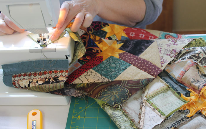 Betsey was working on her Star Surprise quilt from a workshop with Linda Mills.