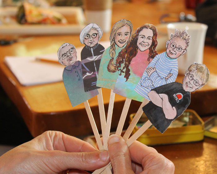 Margi's wonderful stick puppets of herself and Brain and four of their grandchildren