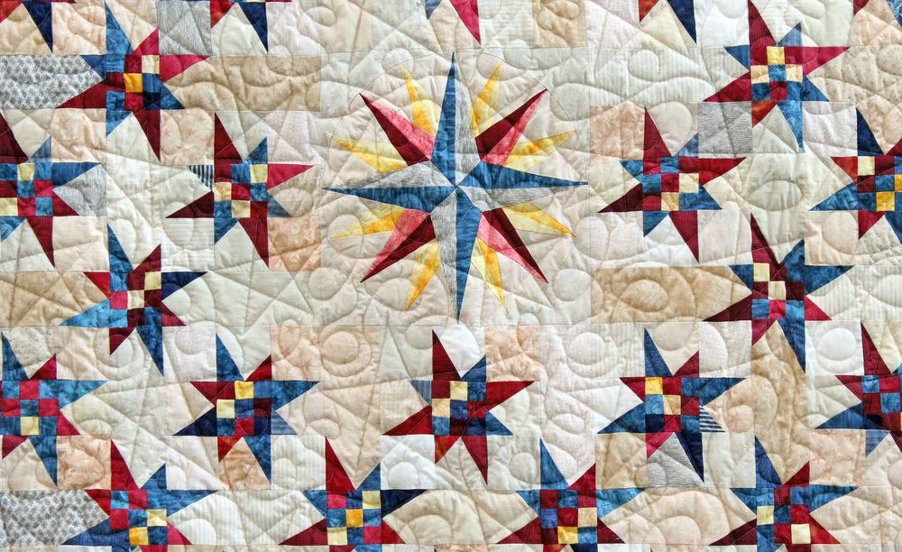 "I call this ""Celestial Compass"". I have no idea what the real name is. Most of the piecing was done by a quilter who can no longer sew or quilt and I offered to finish it for her. I added a row at the top and at the bottom plus the border. it was machine quilted by  Lynn Jones . I will deliver it back to the owner next week. I hope she likes it."