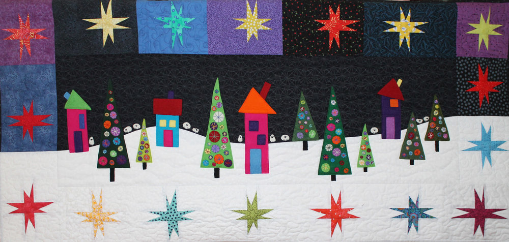 Flocks By Night,  my most recent finish in time for Christmas. The pattern is by Wendy Williams from Australia. I loved making this wallhanging. The houses, trees and sheep are wool applique and hand embroidered, the stars are machine pieced and it was machine quilted by Heather Stewart. I really wanted to hand quilt this one but was afraid of damaging the wool when I put it in the Q-Snap frame to quilt it. Heather did a super job!