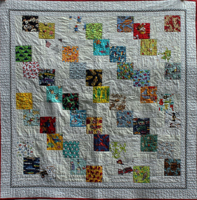 Falling Charms , a story quilt (each print square is different) for great nephew Drew. Machine pieced and machine quilted by Anne Morrell Robinson.