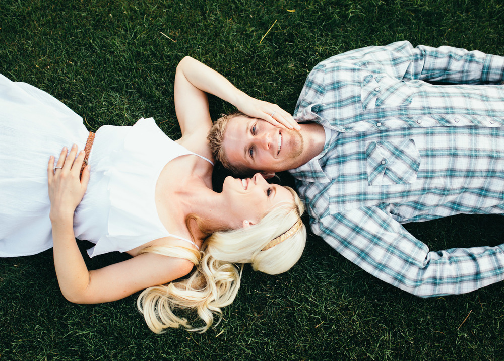 Engagement Couple Laying in Grass