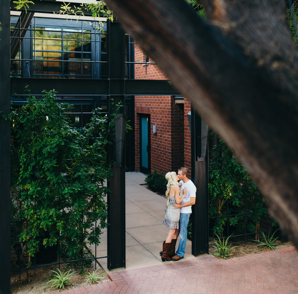 Engagement Couple Kissing Under Arch