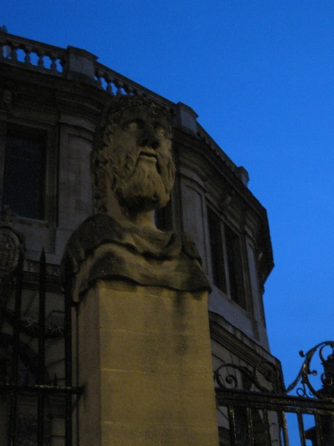 Head statue outside of the Sheldonian Theatre, Oxford, England