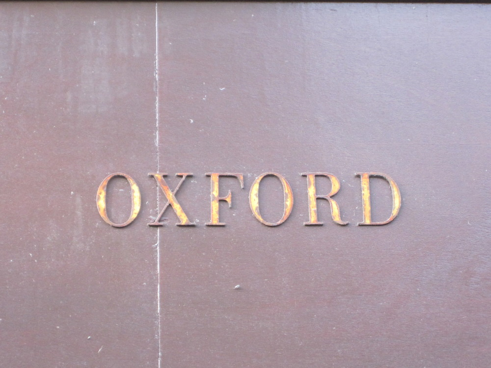 Storefront sign, Oxford, England