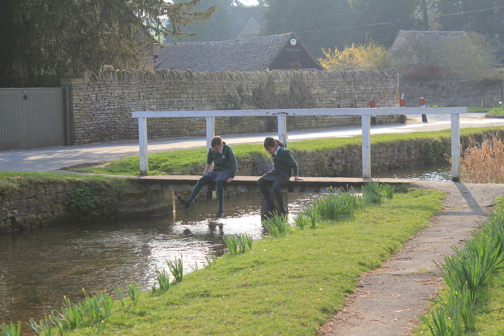 Girls on footbridge in the cotswolds.jpg