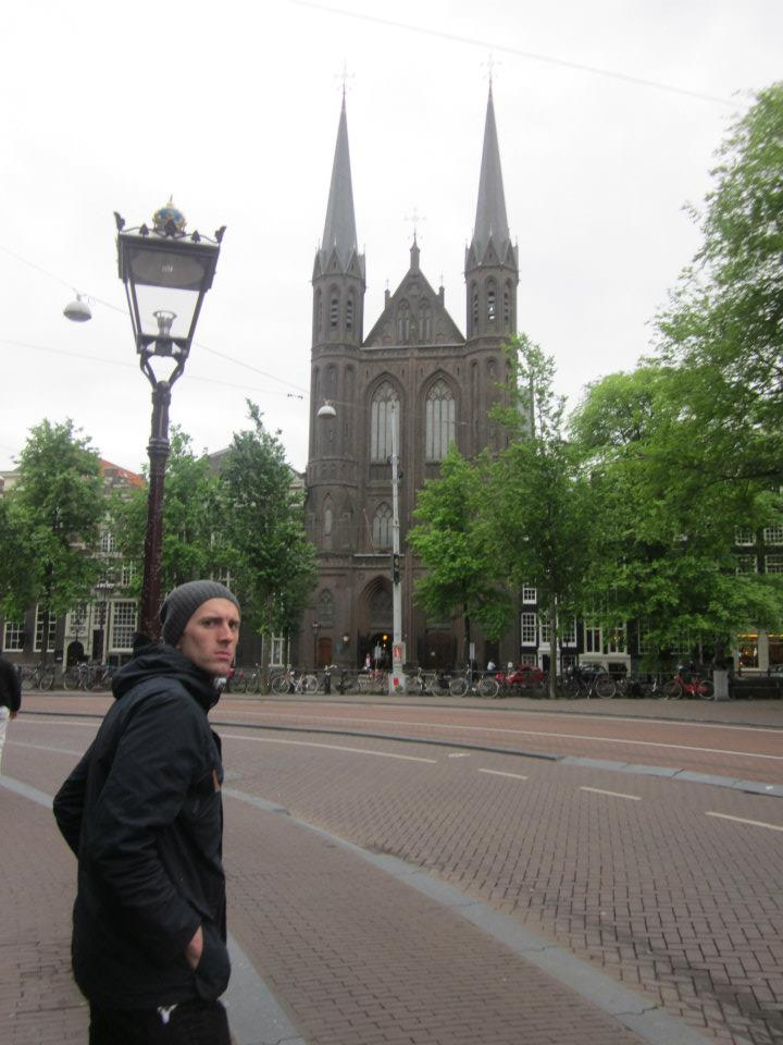 Ryan J Pemberton in front of Amsterdam cathedral