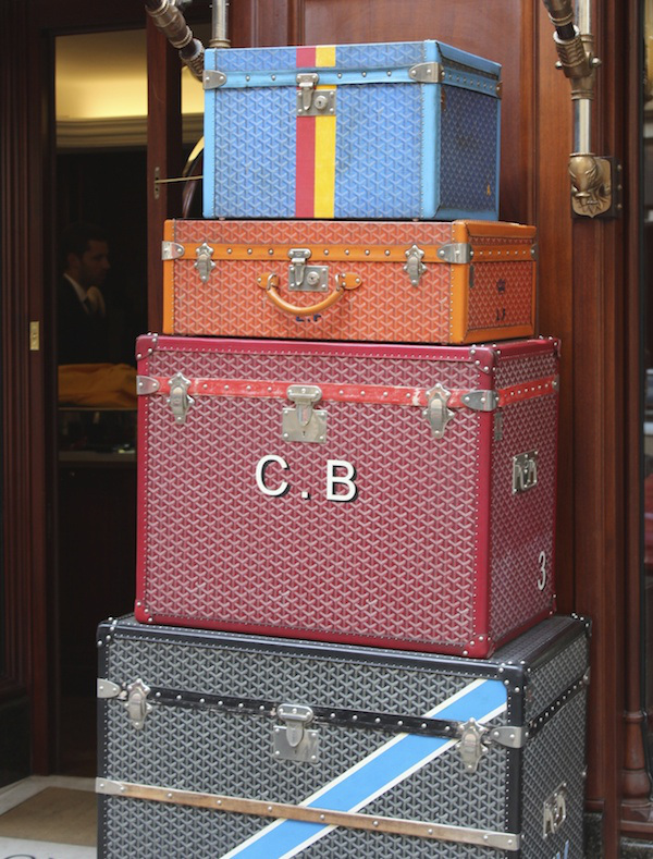 A stack of Goyard trunks in front of the Paris shop