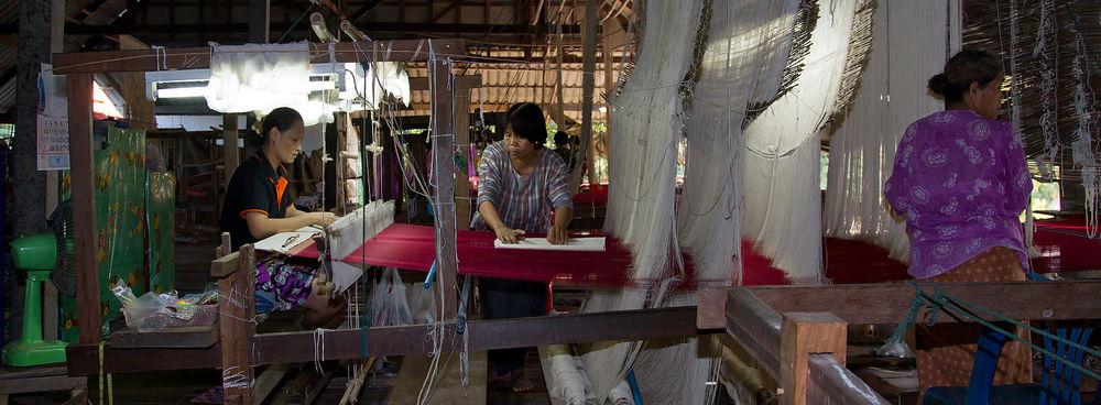 Women operating a handloom in Surin