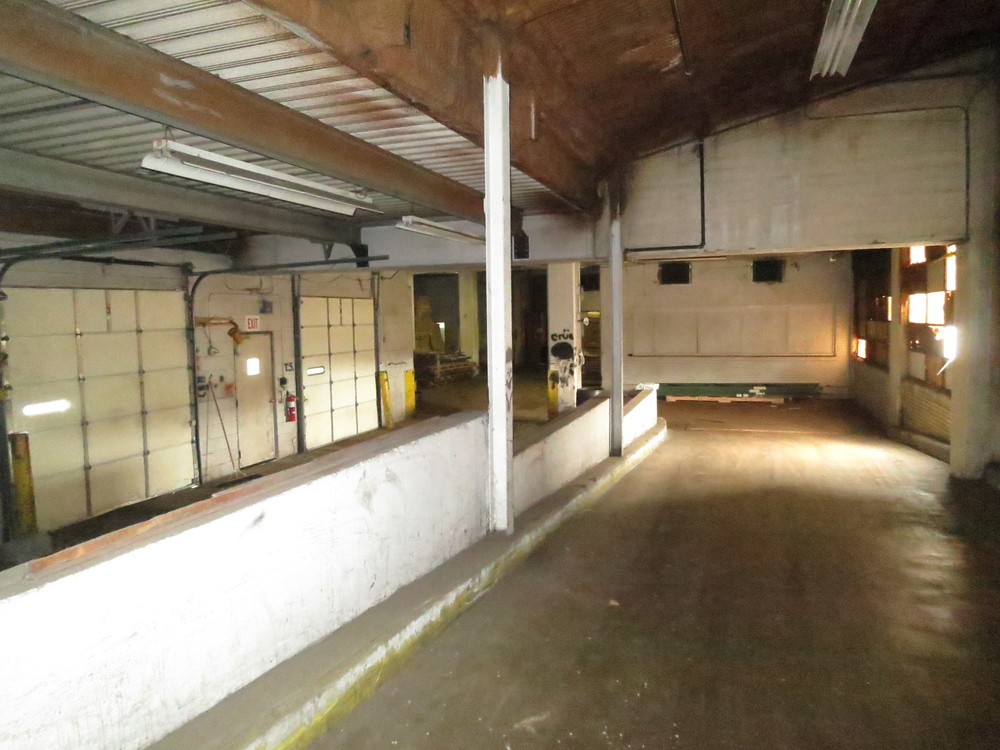End of loading dock and rampway in to three story front building.jpg