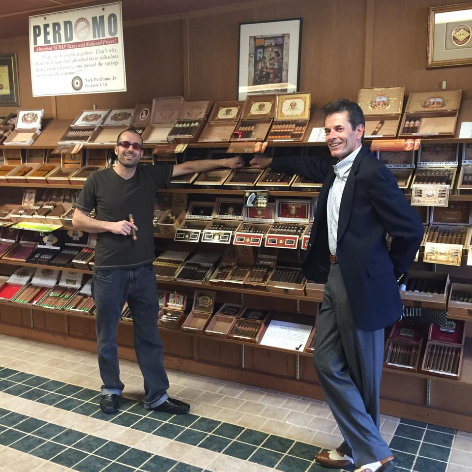 Don Haines, our Perdomo cigar rep and a customer pose in front of Perdomo cigars