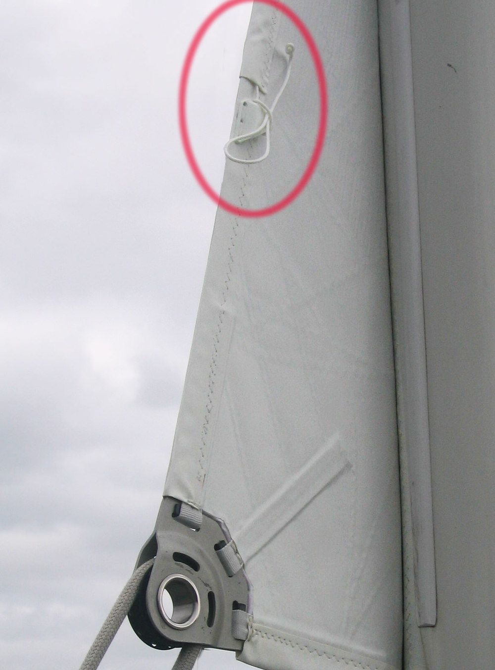 The standard location for a leech line cleat is just above the clew of a mainsail.