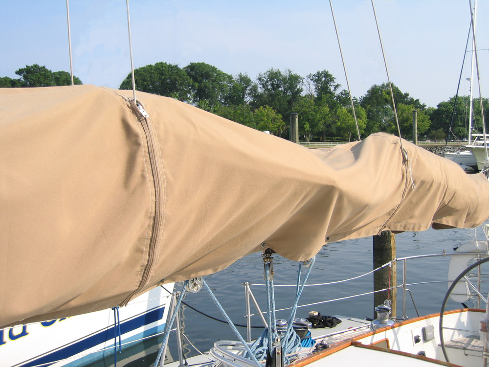 Sail covers need zipper slits to go around lazy jacks when the lazy jacks are left deployed.