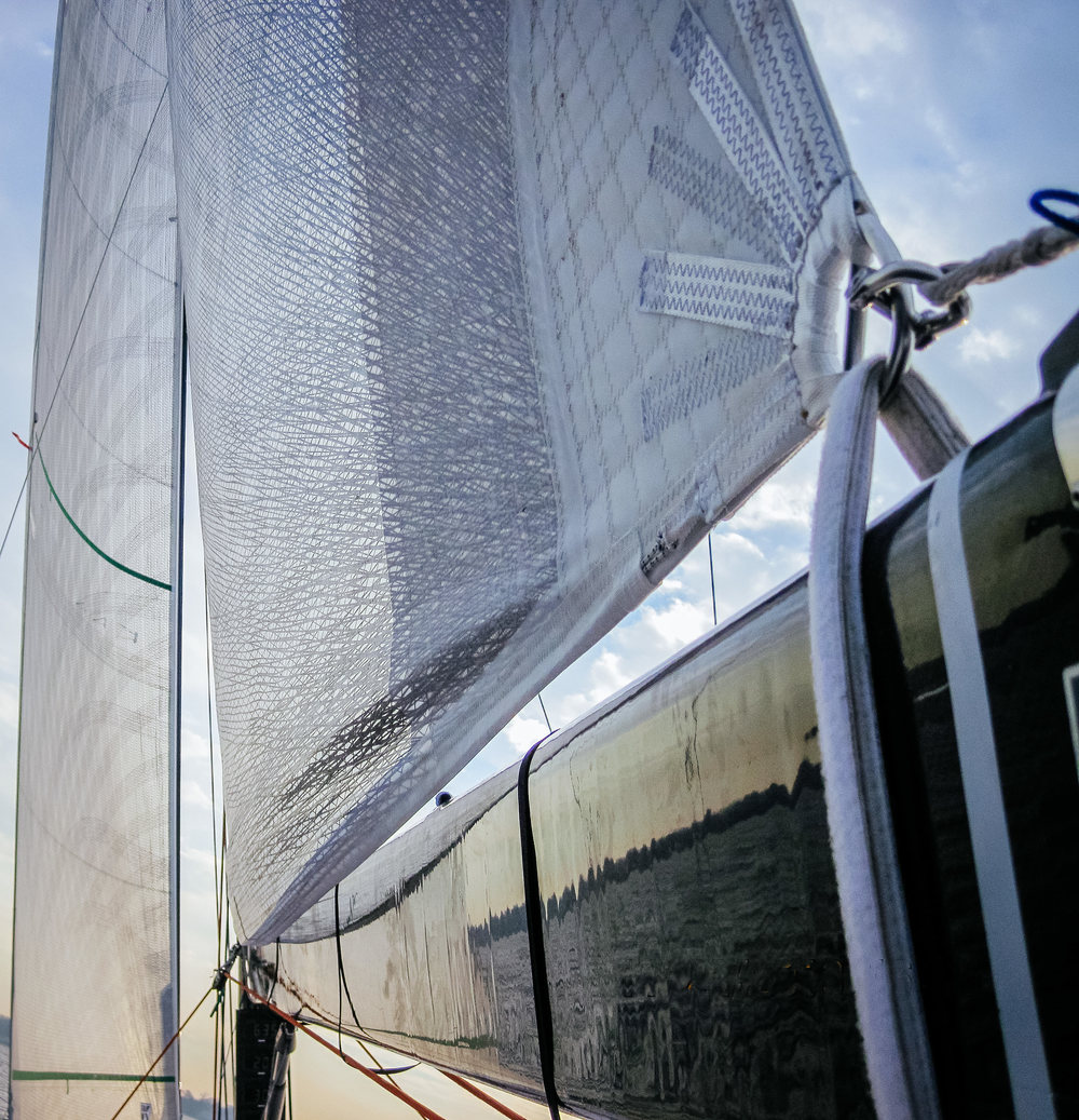 A Titanium loose-footed mainsail. A velcro strap around the boom takes the place of a clew slug or clew car.