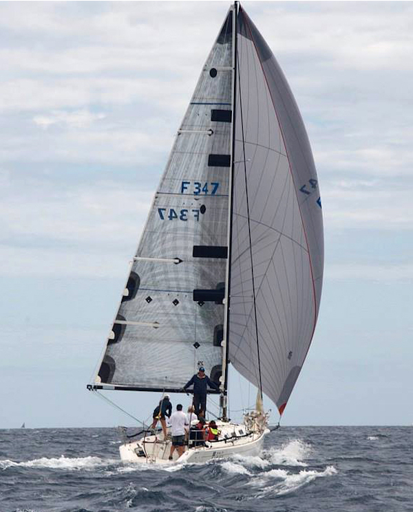 The Beneteau First 34.7 DYNAMIC saying deep in heavy air with her UK Sailmakers A3.