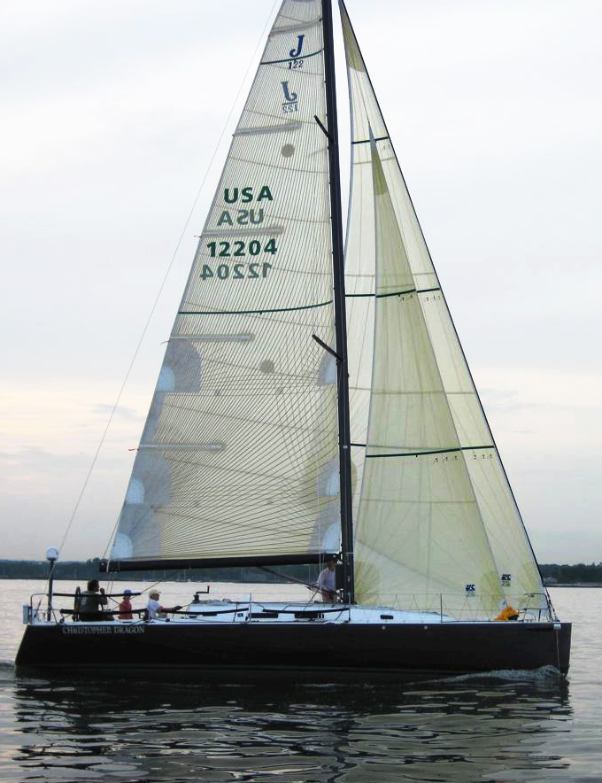 Above and to the right are images of the J/122 Christopher Dragon whose sail plan utilizes non-overlapping jibs. Even so, the Jib Top, with the same LP as the upwind jib, can overlap the mast. The staysail inside the jib top makes a powerful reaching set up.