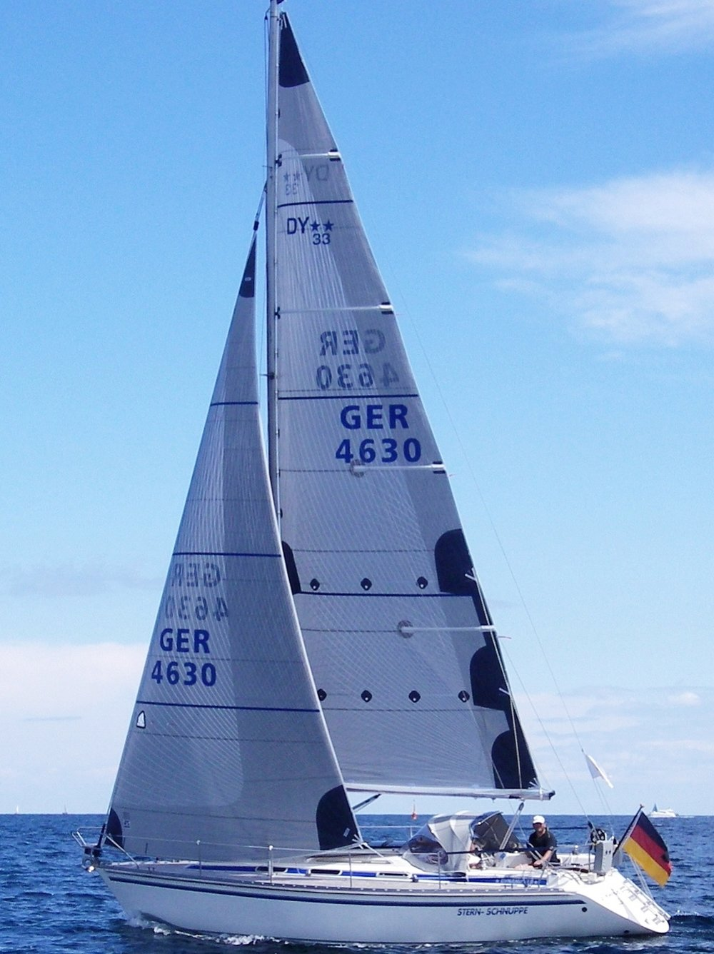 The genoa shown above has taffeta on the part of the sail overlapping the mast to protect the tapes and the sail's mylar layer. This boat's mainsail also has a partial taffeta layer up the whole leech.