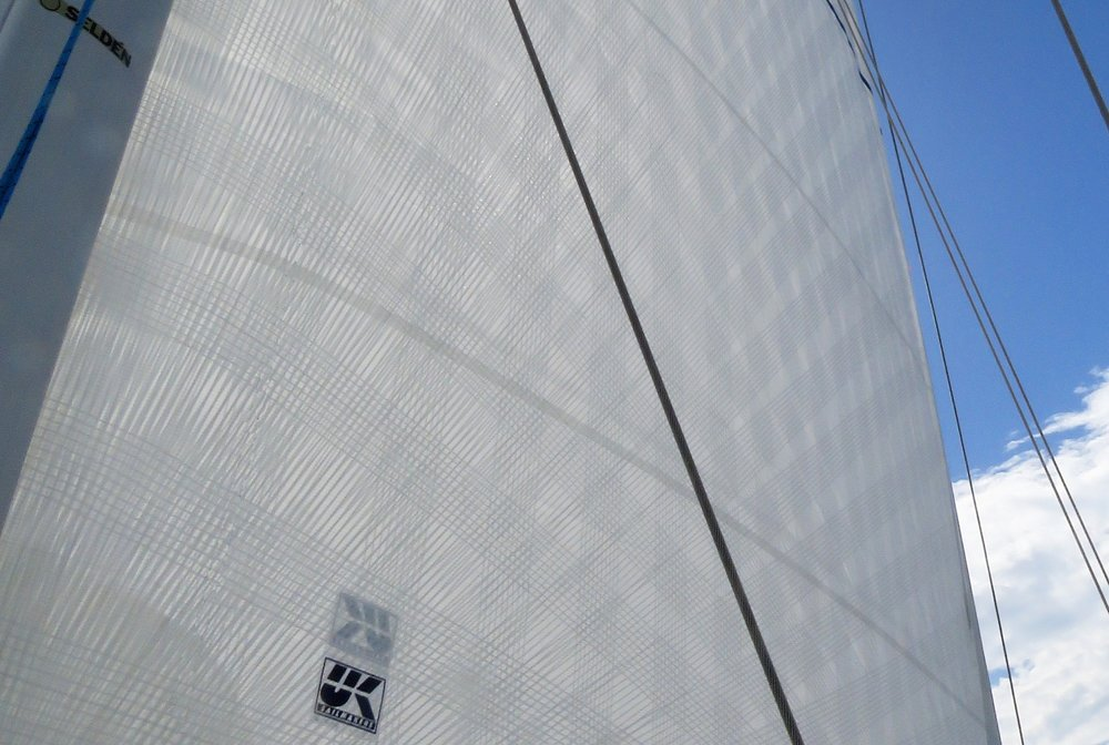 X-Drive Endure   Description:  Loadpath tape-reinforced sail construction for performance cruising and club racing. Allows for an all white appearance.   Construction:  Extra lightweight cross-cut laminate panels reinforced with continuous single ribbon tapes.   Material:  Tapes with Endumax (UHMWPE) ribbons run continuously across the sail in all directions to lock in sail shape. Nearly the same performance as carbon, with all the benefits of Spectra and Dyneema.   Shape Stability:  ★★★★   Durability:  ★★★★   Shape after 500 hours:  Circa 80%   Price:  $$$$