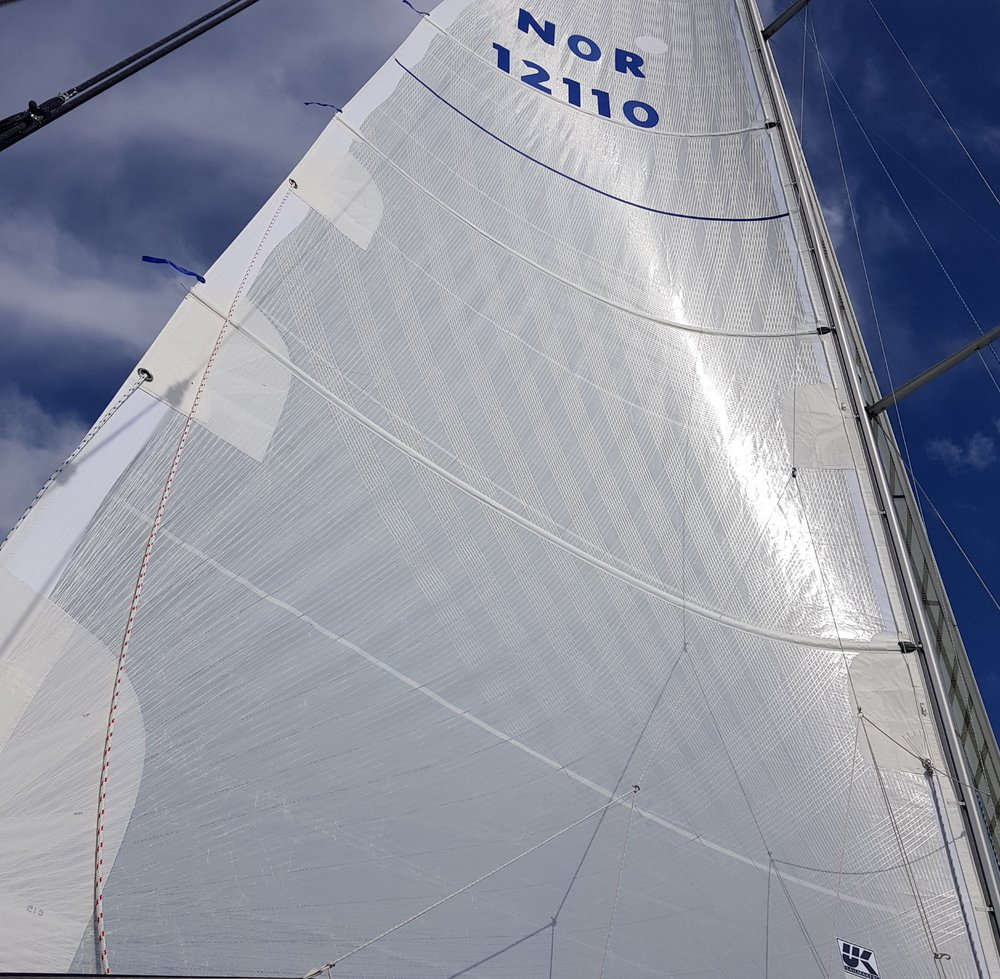 All-white X-Drive full-batten mainsail made with continuous load-path Endumax® filaments -- UK Sailmakers believes these are the strongest all white cruising sails available.
